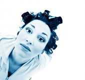 girl in hair curlers. Isolation on the white