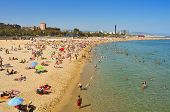 BARCELONA, SPAIN - AUGUST 16: Bathers in Nova Icaria Beach on August 16, 2011 in Barcelona, Spain. T