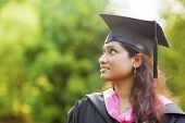 Smiling Young Asian Indian female student looking away with copy space