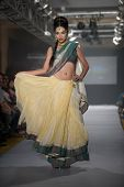 CHENNAI - JULY 21: A model walks on the ramp showcasing Anuradhaa Bisani work during the Chennai International Fashion Week runway on Jul 21, 2012 in Chennai , India.