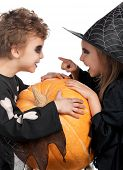 pic of warlock  - Boy and girl wearing halloween costume with pumpkin on white background - JPG