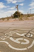 Route 66 Through Ghost Town Ruins In Mojave Desert poster