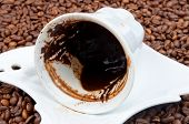 stock photo of sedimentation  - Empty cup of black coffee with coffee sediment - JPG