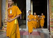 PHUKET, THAILAND - MAY 2: Young unidentified Buddhist monks in the temple Chalong on may 2, 2013 in Phuket, Thailand. 95 percent of the residents of Thailand - Buddhists