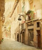 Empty alleyway in Barcelona,  Spain. Carrer de les sitges street . Photo in retro style. Paper textu