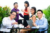 Asian Creative team - young businesspeople are successful with a project