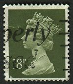 UK-CIRCA 1984:A stamp printed in UK shows image of Elizabeth II is the constitutional monarch of 16 sovereign states known as the Commonwealth realms, in Deep Olive Grey, circa 1984.