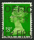 UK-CIRCA 1991:A stamp printed in UK shows image of Elizabeth II is the constitutional monarch of 16