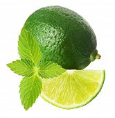 Green lime with  mint leaf isolated on white background.