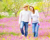 Young loving couple walk in spring park, first love, romantic date, springtime holidays, spending ti