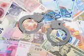 Currency from world with handcuffs