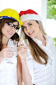 Women Celebrating Happy New Year with Wineglasses