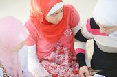 image of muslimah  - Muslim and Arabic girls learning together in group - JPG