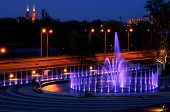 Illuminated Fountain At Night In Warsaw. Poland