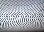 Grey Background Of Perforated Metal Texture.