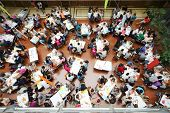 MOSCOW - AUGUST 18: Above view of students at tables in Youth health group at Global Youth Voice - A
