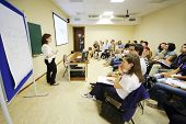 MOSCOW - AUGUST 18: Young people listen to lecturer at Global Youth Voice - AIESEC International Con