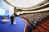 MOSCOW - NOV 14: Members of Forum on stage and audience at Forum Small Business - New Economy, dedic