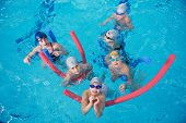 picture of swimming  - happy children kids group  at swimming pool class  learning to swim - JPG