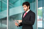 Young businessman using a tablet outdoor