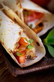 stock photo of sandwich wrap  - Mexican food. Fresh tortilla frajita wraps with chicken and vegetables