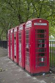 A Row Of Red Phone Booths In London