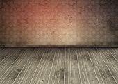 Habitación vacía con el piso sucio y anticuada wallpaper