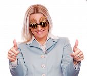 Blonde business woman with thumbs up gesture on the both hand