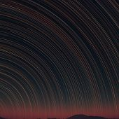 Star Trails And Far Rocks