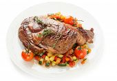 Ribeye steak with stir fried vegetables isolated on white background