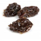 Raisins isolated on white background.