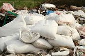 image of smuggling  - Pile of industrial garbage bags at rural - JPG
