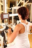Woman doing a work out in a physiotherapy gym