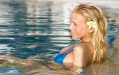 Blonde Girl Relaxing In Water In The Pool