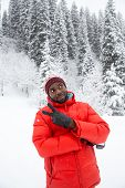 African American Cheerful Man In Ski Suit In Snowy Winter
