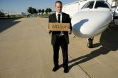 Man Waiting For A Bailout In Front Of A Corporate Jet