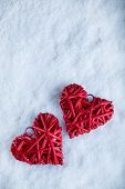 Two beautiful romantic vintage red hearts together on a white snow background. Love and St. Valentines Day concept.