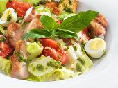 Tasty healthy Caesar salad with sweet basil and lettuce on a round plate
