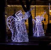 image of angel-trumpet  - Christmas street decorations - angels playing trumpets made of light bulbs fitted to a metal skeleton