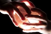 pic of palmistry  - a lighted ball in a persons hands - JPG