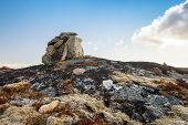 Stone Cairn As A Navigation Mark On The Top Of Norwegian Rock