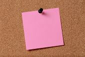 Pink Reminder Sticky Note On Cork Board