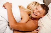 Lovers Happy In Bed Hugging Each Other