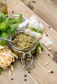 stock photo of pesto sauce  - Pesto Sauce with ingredients on wooden background - JPG