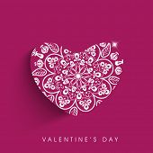 Valentines day background with beautiful floral decorated heart on pink.