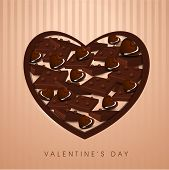 Valentines day background with delicious  chocolaty heart on vintage background.