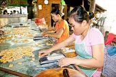 BEN TRE, VIETNAM-NOV 18, 2013: Coconut candy manufacture in Que Dua at Ben Tre , Mekong delta , Viet