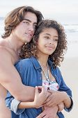 Young Couple Embracing At Beach