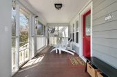 picture of screen-porch  - Porch in suburban home with red door - JPG