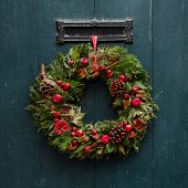 foto of yule  - Advent Christmas wreath on wooden door decoration - JPG